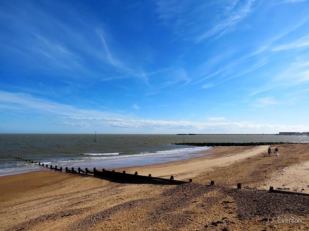Blue Sky And A Beach - Walton On Naze Essex  by J J  Everson