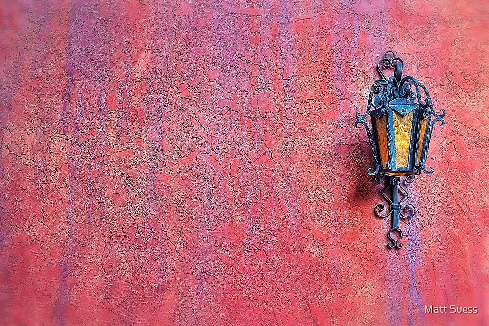 Lantern and adobe wall by Matt Suess