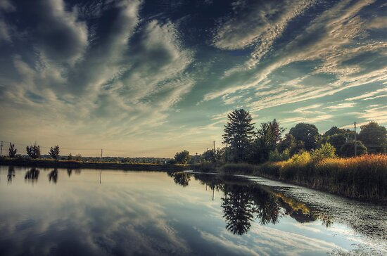 Clouds Above, Reflections below.. by Aaron Campbell