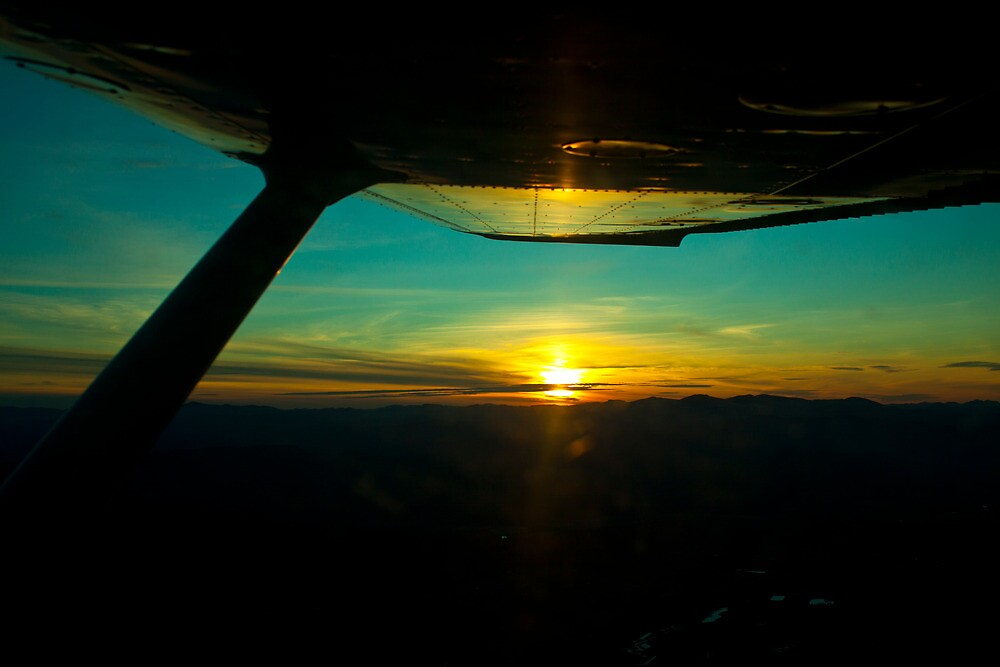 Sunset from a Cessna by Keegan McCarthy