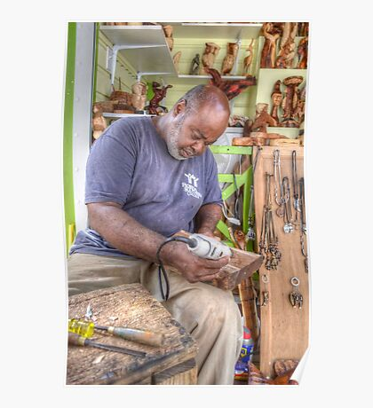 Bahamian Sculptor carving the Wood Poster