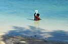 Bahamian woman taking a morning bath in the ocean by Jeremy Lavender Photography