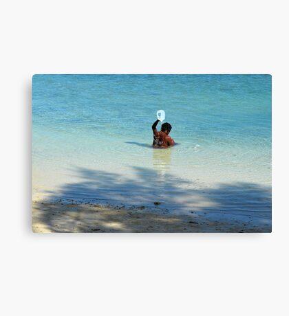 Bahamian woman taking a morning bath in the ocean Canvas Print