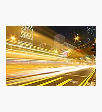 Traffic in modern city at night Photographic Print