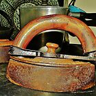Antique Iron on an Antique Stove by Martha Sherman