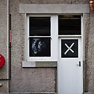 The face at the window, the cross on the door by Rhoufi