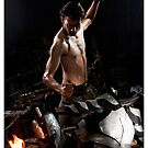 Hammering iron on an anvil. by PhotoStock-Isra