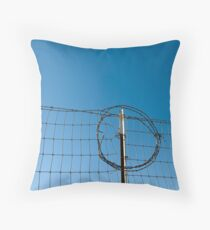 Section of a fence topped by barbed wire Throw Pillow