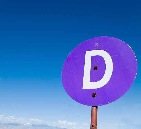 Circular purple sign with the letter 'D' by Jeff Knapp