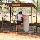 Drysdale River Station, telephone booth/retired refrigerator by Margaret  Hyde