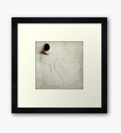 Heartstring Framed Print