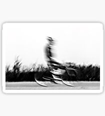 Motion blur of a bicycle rider in black and white  Sticker
