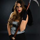 Grim reaper female DEATH carrying scythe by PhotoStock-Isra