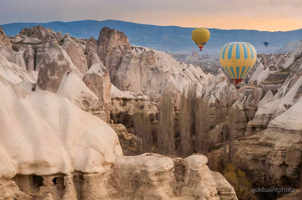 Hot-air balloons flying over Cappadocia by goldsaintphoto