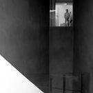 Man in Window by Andrew  Makowiecki
