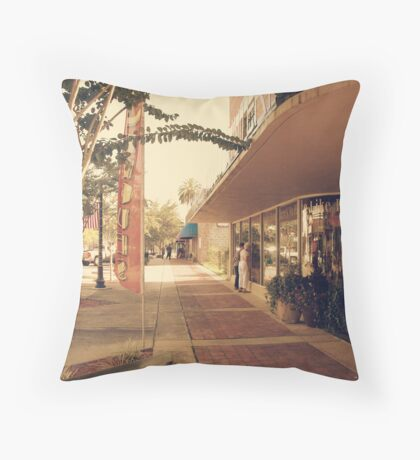 looking at the displays Throw Pillow