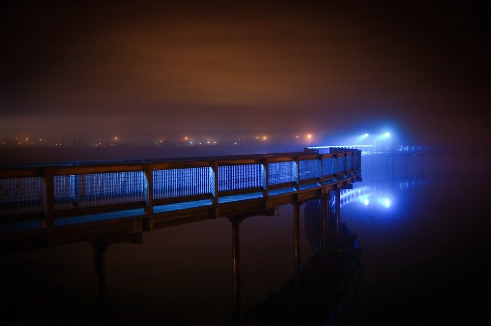 Lighted foot bridge in the fog by Jean-Paul Boudreau