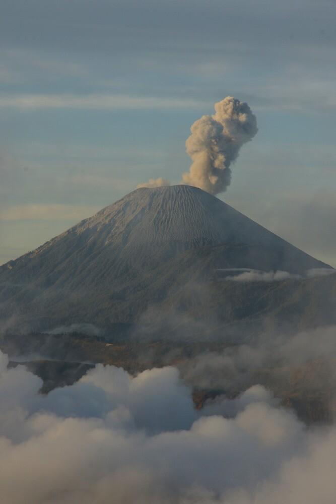 Early morning eruption. Mt Semeru, Java. Indonesia. by Ian Hallmond