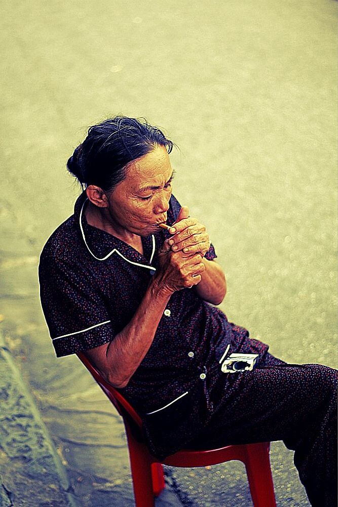 Old lady smoking Hoi An, Vietnam by bouche