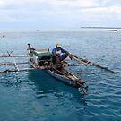 Fisherman at Ayu Atoll by Reef Ecoimages