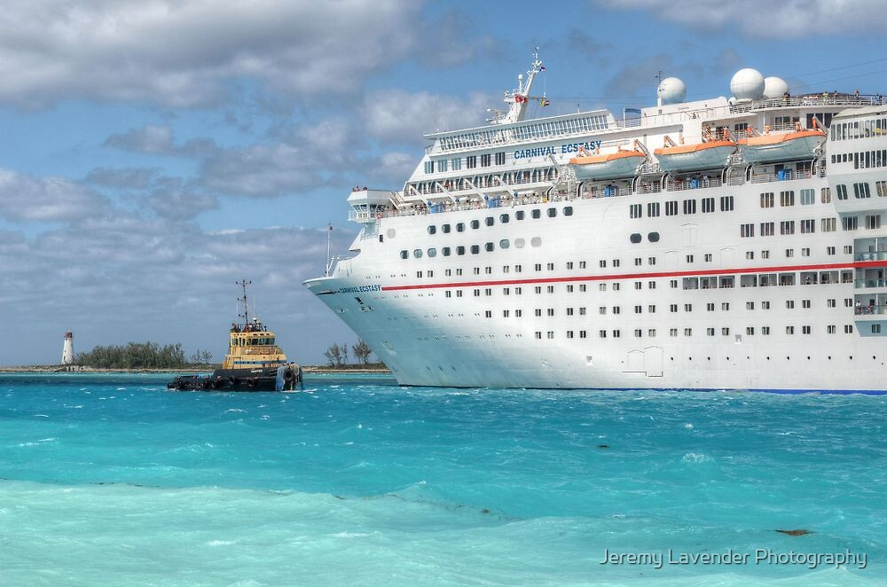 """""""Carnival Ecstasy"""" getting a little help from """"Snapper"""" in Nassau Harbour, The Bahamas by Jeremy Lavender Photography"""