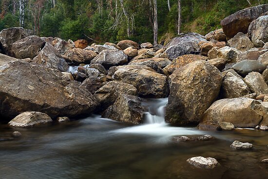Boulders on the River by Mark  Lucey