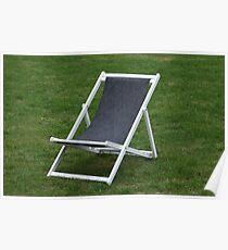 deck chair on green grass Poster