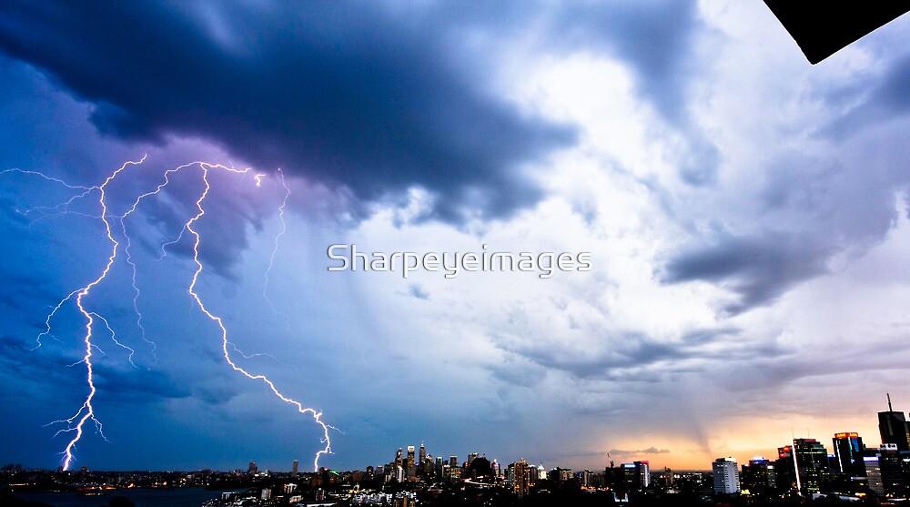Lightning storm at night over Sydney city, Australia by Sharpeyeimages