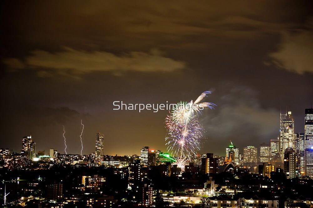 Lightning storm and fireworks over Sydney city, Australia  by Sharpeyeimages