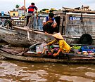 Can Tho floating market by Ian Fegent