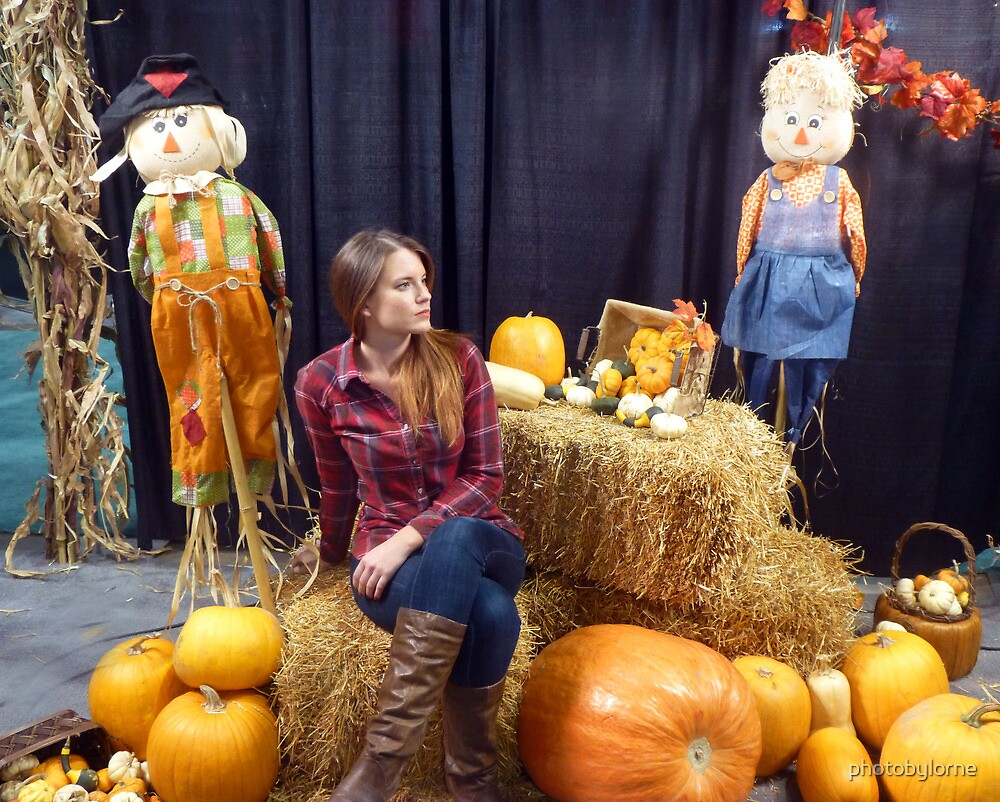 Woman with Pumpkins On Hay by photobylorne