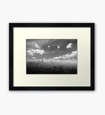 City in the  pollutions fog  Framed Print