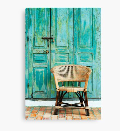 old door and chair  Canvas Print