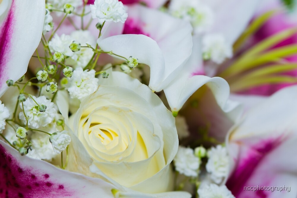 Close up of a bouquet of roses, lilies and other flowers by nscphotography