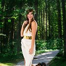 Greek Goddess with dog in a lush forest  by PhotoStock-Isra
