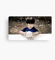My son and his ball time Canvas Print