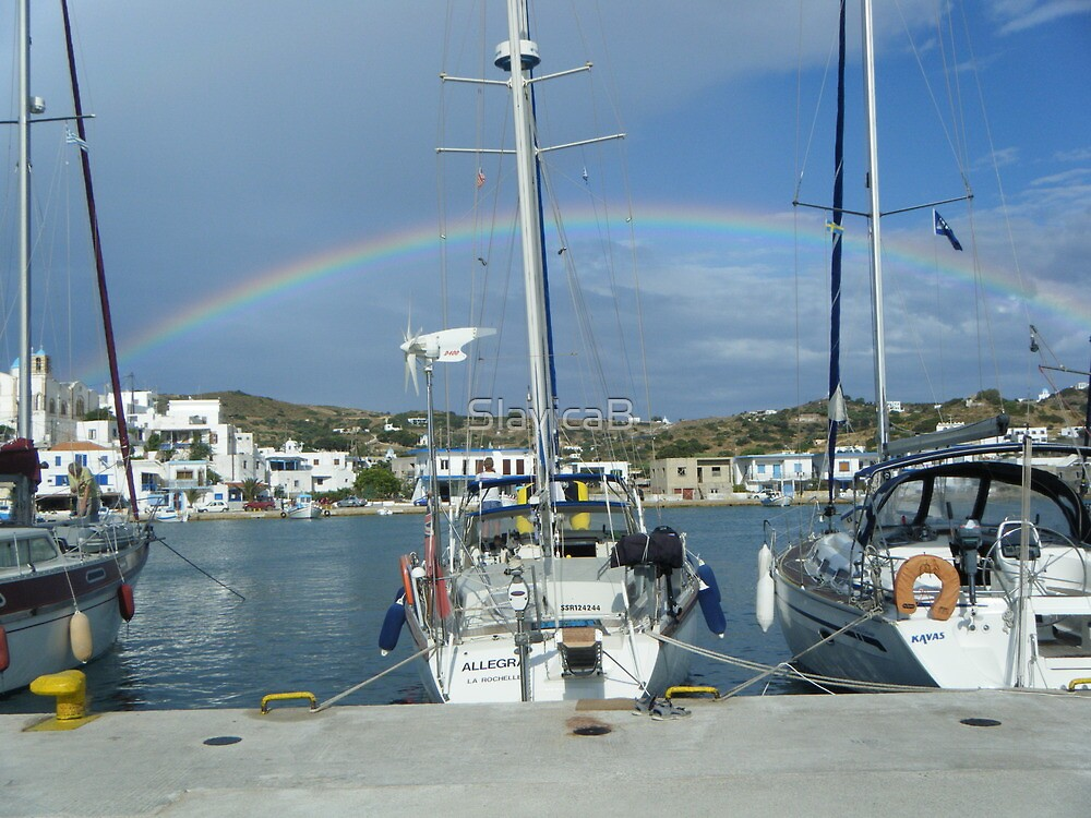 Full rainbow over Sailboat in Greek Island by SlavicaB