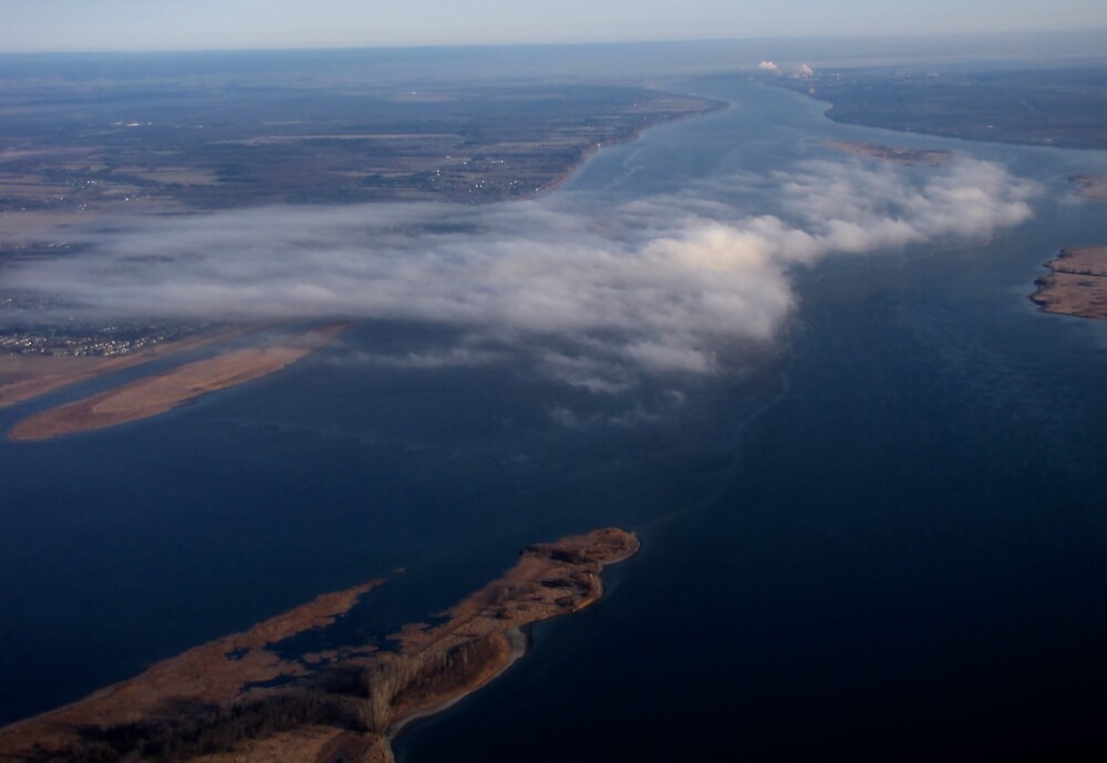 Early morning fog over the St. Lawrence by AndreCosto