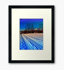 Traces on a winter hiking trail Framed Print