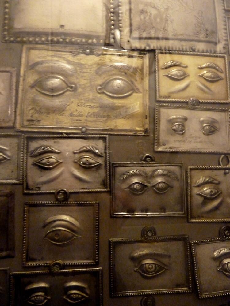 Wall of votives in Czestochowa, Poland by docnaus