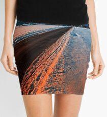 Winter road at sundown Mini Skirt