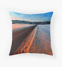 Winter road at sundown Throw Pillow