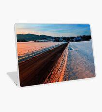 Winter road at sundown Laptop Skin