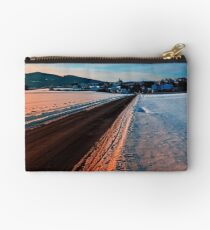 Winter road at sundown Studio Pouch
