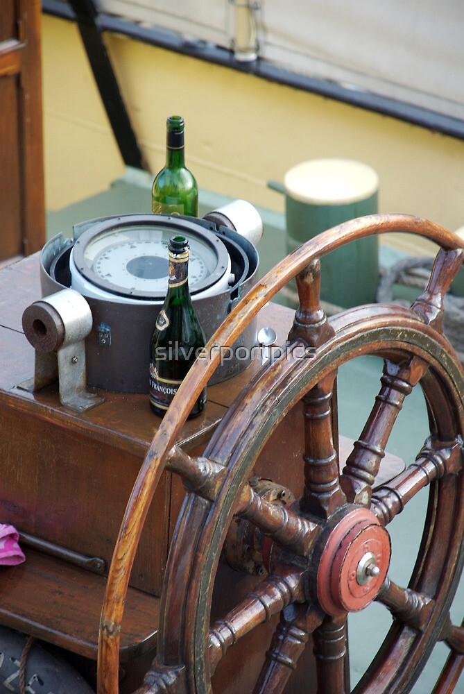 Champagne and wine bottle next to ships wheel, Brest 2008 Maritime Festival, Brittany, France by silverportpics