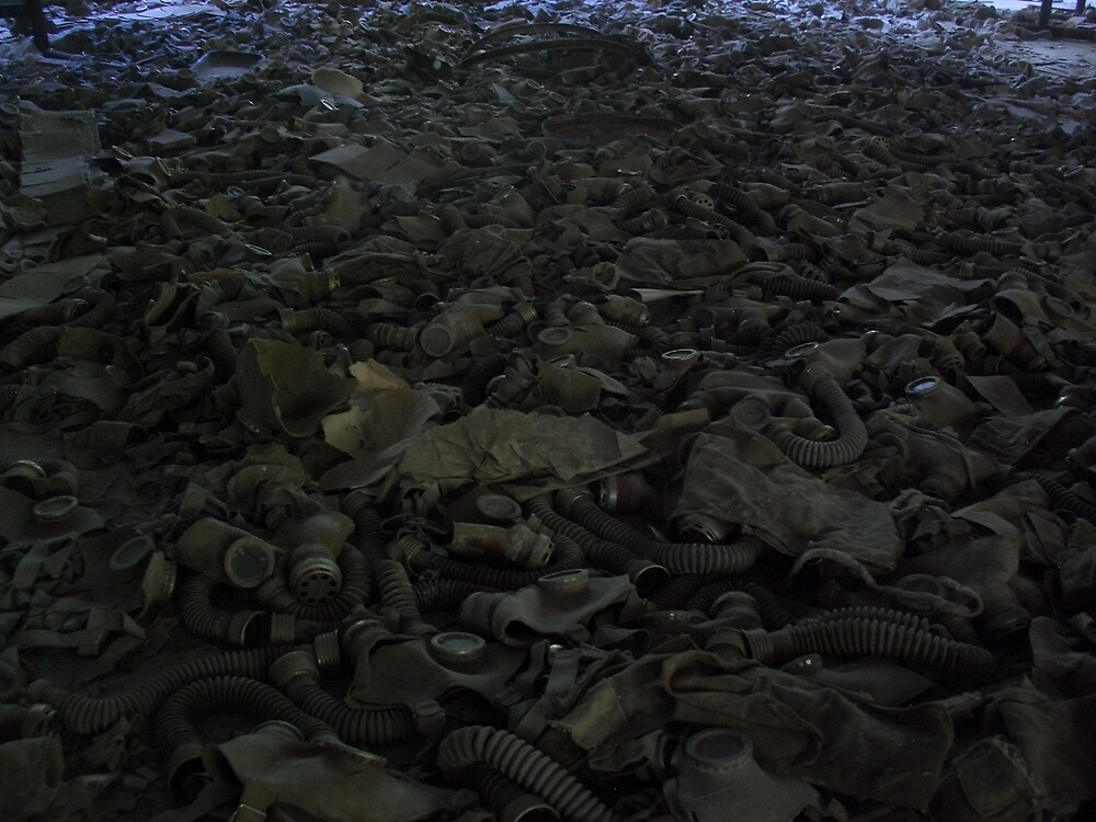 Heap of gas masks, Chernobyl exclusion zone by Giles Thomas