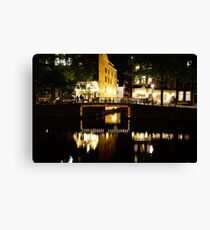 Reflections in the canal at night in Amsterdam, Netherlands  Canvas Print