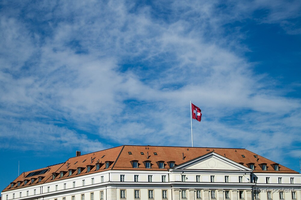 Switzerland : flag and house on a blue sky  by hpostant