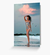 Beautiful brunette posing sexy at the tropical beach during sunset time Greeting Card