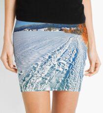Hiking through a sunny winter scenery Mini Skirt